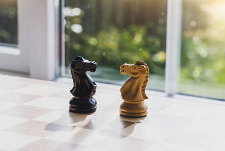 Selective focus of wood knight chess on board game with blurry background, Business leader and confrontation solve problems concept, Chess horse on board with copy space 版權商用圖片