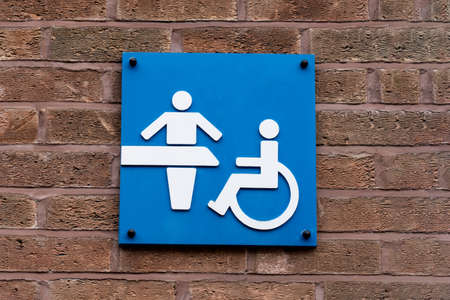 Changing room and Disable toilet sign on blue, WC symbol toilets icon in public restroom sign family room and disabled on wheelchair symbol on brick wall