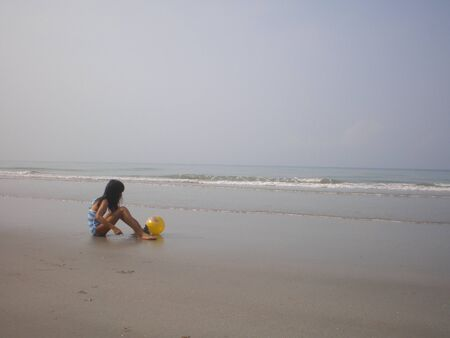 a girl  play sand at seaside Stock Photo - 9378017