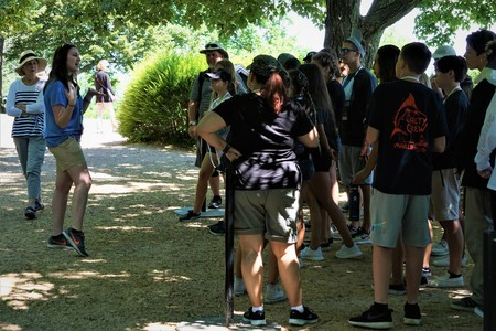 Charlottesville, Virginia , USA, June 5,2018 ;The lady guide explains the tourists before having sightseeing in The Home Flowers Garden of Thomas Jefferson.