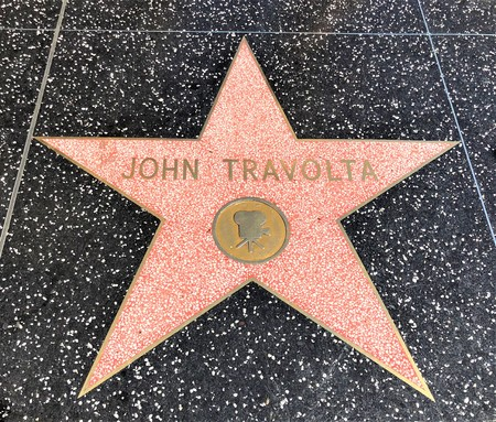 Hollywood, LA, USA - September 18, 2018: John Travolta's star sign on Hollywood Walk of Fame is located on Hollywood Blvd.