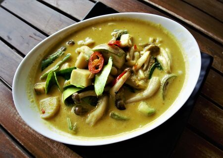 Mushroom Green Curry, popular Thai dish on the wooden table background, Huahin Thailand. 스톡 콘텐츠