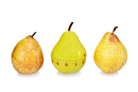 Two ripe fresh pears and plastic pear timer (stand out of the crowd concept) photo