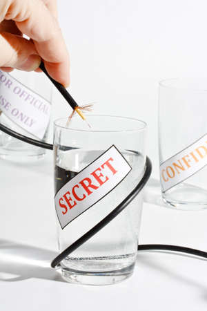 corporate espionage: Concept for leaking of secret information Stock Photo