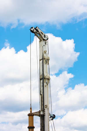 gimlet: Auger detail part over blue sky with clouds Stock Photo