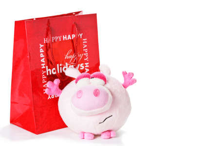 horozontal: Toy pink piglet as christmas gift isolated on white