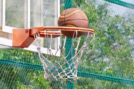 backboard: Basketball hoop on acrylic backboard and ball