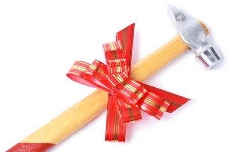 goldish: Hammer with red goldish striped bow as a gift for handyman isolated on white background