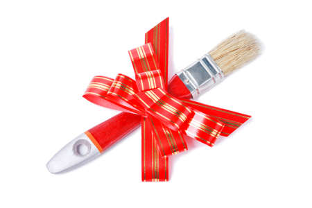 goldish: Paintbrush with red goldish striped bow as a gift for painter isolated on white background