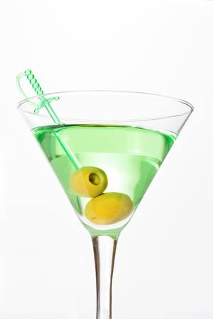 Green alcohol cocktail with dry martini and two olives on skewer Stock Photo - 8830910