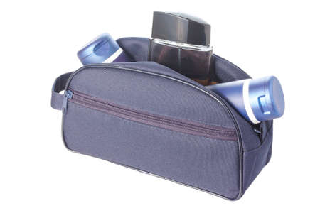 eau de toilette: Open blue travel toiletries bag with man`s cosmetics isolated against a white background