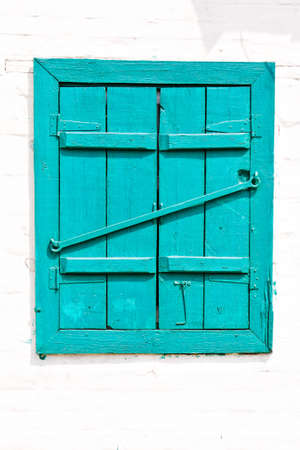 Window with �losed wooden painted blue shutters background photo
