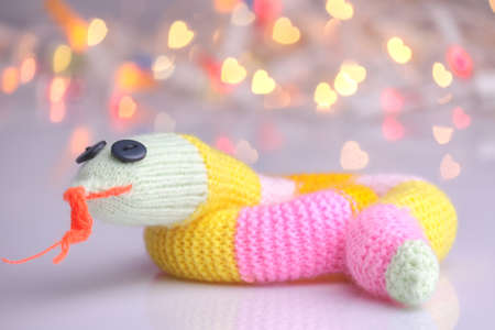 Happy cute knitted snake as 2013 New Year symbol photo