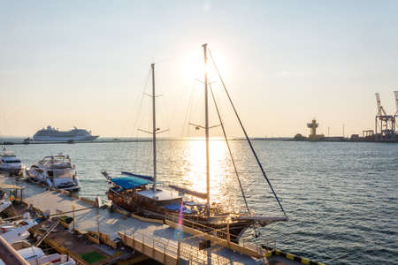 starboard: Yacht in the Black sea harbor in sunrise Stock Photo