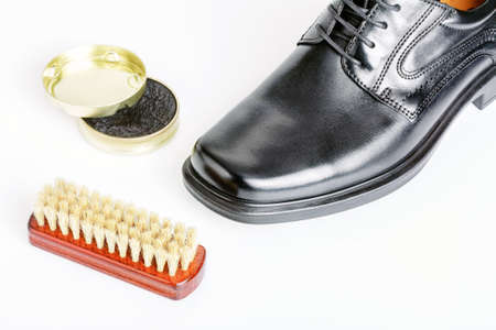 blacking: Classic shiny black mens shoe, boot polish and brush