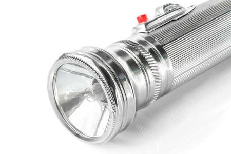 Old metal pocket flashlight isolated on white background photo