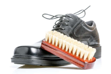 blacking: Classic shiny black mens shoe and brush