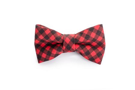 lazo regalo: Corbata de lazo de la tela escocesa de cerca en blanco aislado en fondo blanco