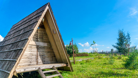 characteristic: Exterior view of a triangle wood cabin