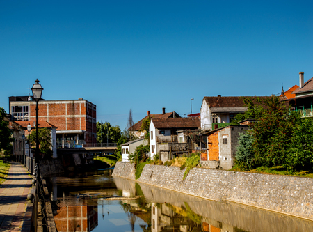 Photo was taken in the city of Pakrac. View on the river Pakra and on the right local promenade called by locals Venice