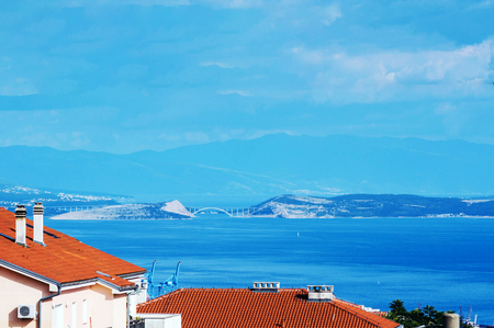 Looking towards Krk island from my balcony in Rijeka. Blue sky and blue sea Imagens