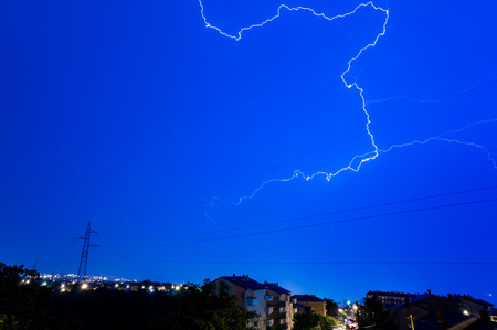Thunderstorm with lightning on night sky over city of Rijeka Imagens