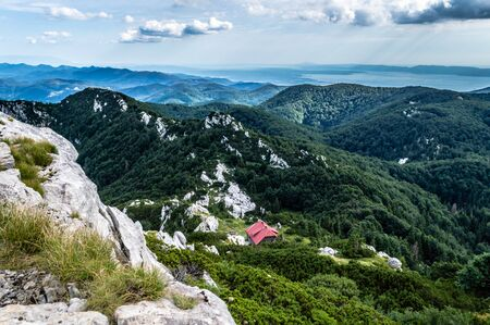 Photo taken after hiking/climbing to the Big Risnjak peak Elevation: 1,528 m. Looking on Schlosser`s mountain hut, and Adriatic sea in background