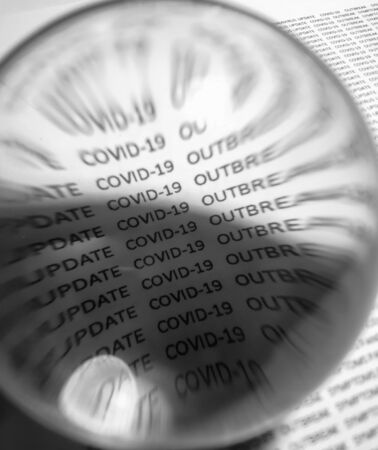Coronavirus outbreak text trough glass sphere
