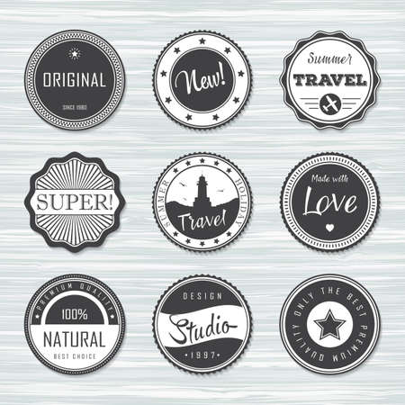 Retro badges for your design on wooden background. Vector illustration. Archivio Fotografico - 132759780