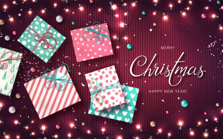 Xmas background with christmas lights, baubles, gift boxes and confetti. Holiday glowing garlands of LED light bulbs on knitted texture. Decorations of realistic colorful lamps for new year cards Archivio Fotografico - 135006396