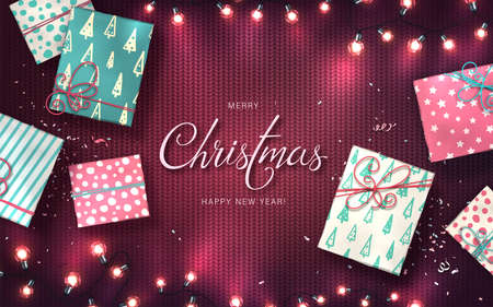 Xmas background with christmas lights, baubles, gift boxes and confetti. Holiday glowing garlands of LED light bulbs on knitted texture. Decorations of realistic colorful lamps for new year cards