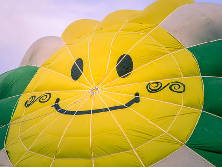 aerostatic balloon center with drawing of a smiling face