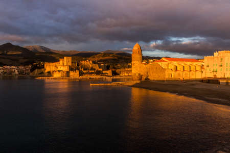Dawn overlooking the town of Coliure with the church inside the sea and medieval castle. France