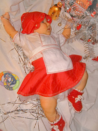 Baby in a Christmas fairy red white dress