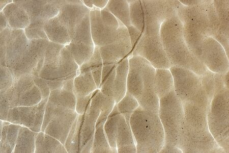 Texture of water transparent blue ripples sand bottom Stock Photo