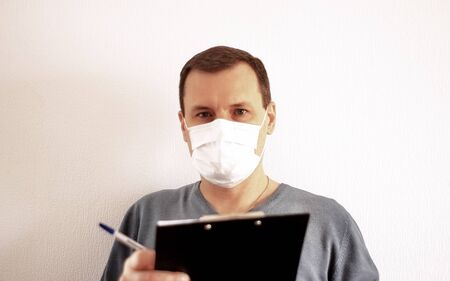 Male Employee In White Medical Mask At Work