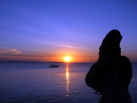 at ease: Relaxing in the Sunset, Zanzibar, Tanzania