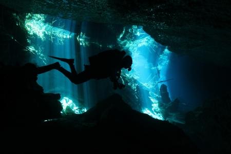 Diver in Chac-Mool Cenote, Playa del Carmen, Mexico photo