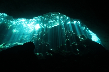 Sunbeams Breaking Through the Surface in Chac-Mool Cenote, Playa del Carmen, Mexico Stock Photo