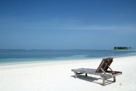 south male atoll: Deckchair on the White Sand Beach of Bodufinolhu  Fun Island , South Male Atoll, Maldives Stock Photo