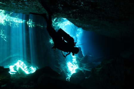 Diver in Chacmool Cenote, Playa del Carmen, Mexico photo