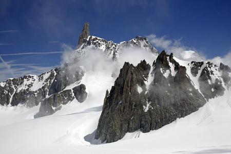 View of 4,013 m peak Dent du Géant, or Dente del Gigante, and Glacier de Géant, in the Mont Blanc Massif. Aosta Valley, Italy