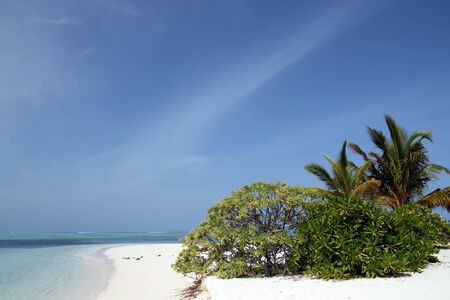 atoll: Tropical Beach with White Sand, Turqoise Water and Tropical Vegetation. Bodufinolhu, aka Fun Island, South Male Atoll, Maldives Stock Photo