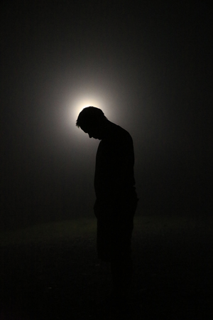 Silhouette in the Dark, Head Leaning Forward with Light behind