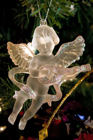 Crystal angel christmas decorations. Golden light.