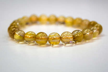 Golden Rutilated Quartz with a white background