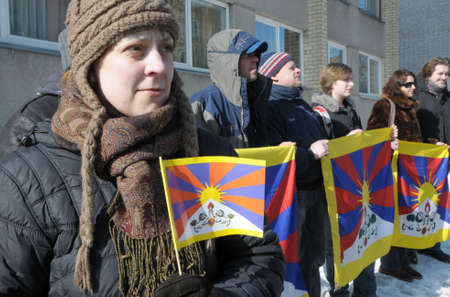 demonstrators: Vilnius, Lithuania - March 10, 2010: In commemoration of Tibet rebellion (10-03-1959). Demonstrators asking for free Tibet at the Chinese embassy in Vilnius, Lithuania.