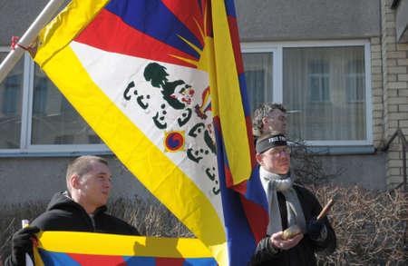 demonstrators: Vilnius, Lithuania - March 10, 2010: In commemoration of Tibet rebellion (10-03-1959). Demonstrators asking for free Tibet at the Chinese embassy in Vilnius, Lithuania.