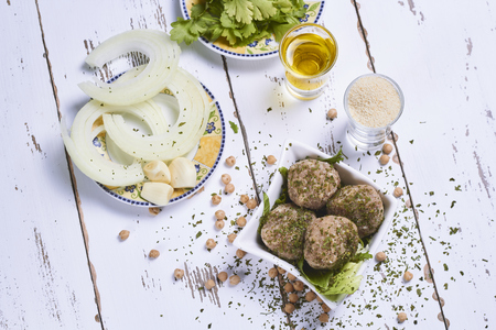 raw ingredients to make falafel with chickpeas and veal