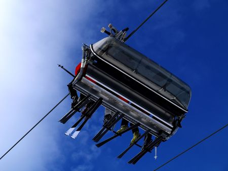 A ski lift carrying skiers. photo